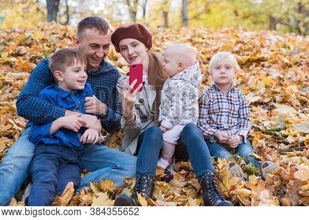 Big Happy Family Having Fun In Autumn Park. Mum Dad And Three Children.
