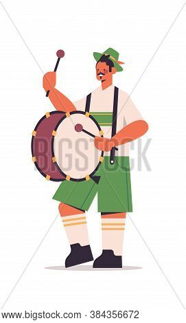Musician Playing Drum On Biggest Folk Festival Oktoberfest Party Concept Man In German Traditional C