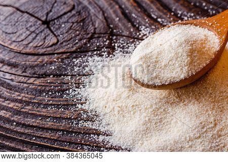 Natural Organic Semolina On Dark Wooden Rustic Background