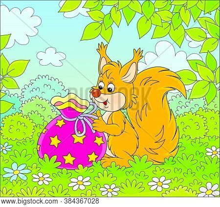 Joyful And Friendly Smiling Red Squirrel Holding A Beautiful Bag With A Holiday Gift On A Green Fore