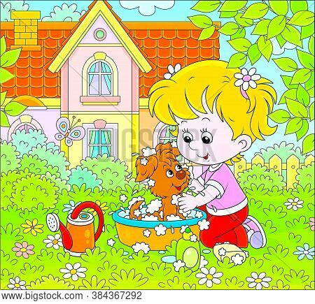 Cute Little Girl Washing Her Small Puppy In A Basin With Lather On A Green Lawn In Front Of A Colorf