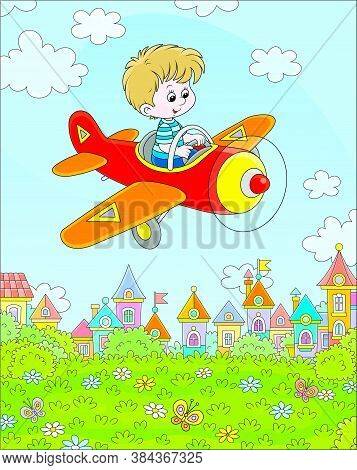 Little Boy Piloting His Small Toy Plane Among White Clouds In Blue Summer Sky Over A Green Park Near