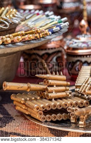 Sarajevo, BiH - August 27, 2019: Metal toy tanks and other toys made from bullets left after the Bosnian war. Souvenir shop in old town of Sarajevo, Bosnia and Herzegovina