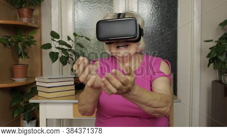 Amazed Senior Grandmother In Virtual Headset Glasses Watching Amazing 3d Video In 360 Vr Helmet At H