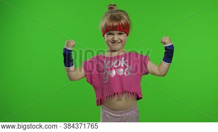 Little Caucasian Girl In Pink Sports Suit Making Fitness Gymnast Home Exercises. Workout For Kids. Y