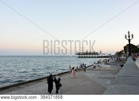 Yalta, Crimea September 6, 2017: View Of The Evening Embankment Of The City Of Yalta