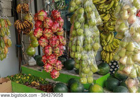 Tropical Fruit Organic Dragon Fruit On Walking Street Market. Fruits At Traditional Market In Bali.