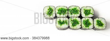 Sushi Roll With Chuka On A White Plate, Classic Japanese Sushi. Traditional Japanese Food With Maki.