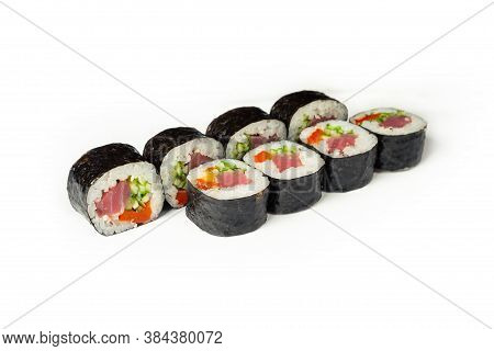 Sushi Roll With Tuna And Vegetables On A White Plate, Classic Japanese Sushi. Traditional Japanese F