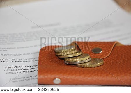 Brown Leather Wallet, Coins Put On Agreement. Business Invesment And Realestate Concept. Selective F