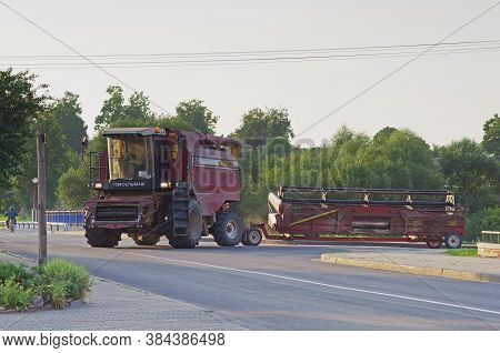 Belarus - August 10, 2013: Combine Harvester Palesse Gs12 With Threshing-separating Device Rides On