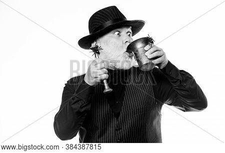 Halloween Concept. Strange People. Preparing Magic Halloween Drink. Elegant Bartender Wear Hat And V
