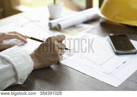 Architect's Desk, Architects Are Analyzing The House Structure, Focus On The Hand, Close Up.