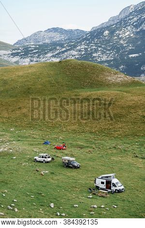 Zabljak, Montenegro - 23 July 2020: Tourists Set Up A Car Camp In The Mountains, On The Green Grass.