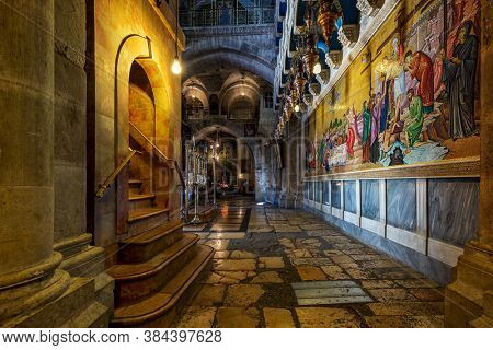 JERUSALEM, ISRAEL - JULY 14, 2019: Interiors of the Church of the Holy Sepulchre - a place known as Calvary or Golgotha, and Jesus's empty tomb, where he was buried and resurrected.