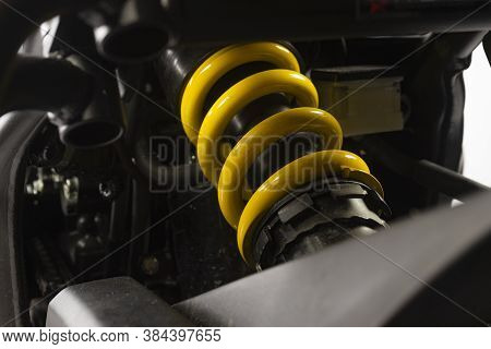 Close Up Of Motorcycle Superbike Yellow Shock Absorber And Spring Of The Back Wheel