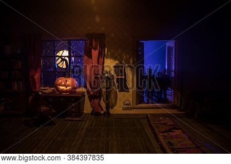 A Realistic Dollhouse Living Room With Furniture And Window At Night. Artwork Table Decoration With