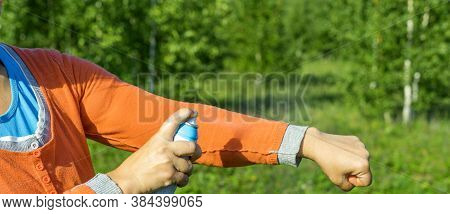 Insect Repellent Applying On Caucasian Women Hand. Woman Spraying Mosquito Repellent On Hand. Skin P