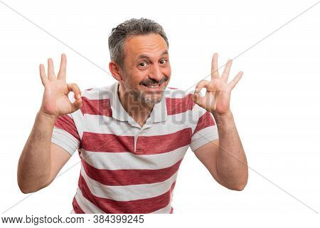 Happy Cheerful Man Smiling As Making Double Okay Sign Approve Gesture Using Fingers With Blank Copys