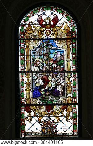 ZAGREB, CROATIA - MAY 16, 2013: Jesus the Friend of Children, stained glass window in the Church of Saint Catherine of Alexandria in Zagreb, Croatia