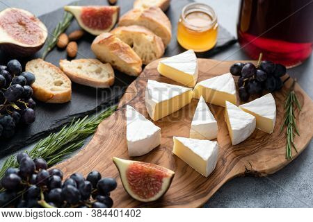 Camambert Cheese With Figs, Grapes, Honey And Wine. Gourmet Food, Appetizer Cheese Plate