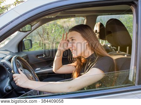 Stressed Young Woman Driver With Red Hair Is Sitting Inside Her Car And Swearing At Other Drivers. T
