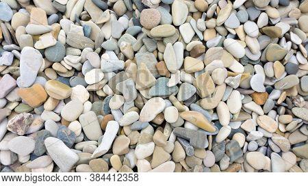 Mosaic Sea Pebbles Background. Texture Of Small Marine Multi-colored Pebbles. Marine Design Template