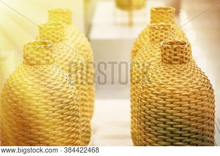 Several Jugs Of Wine In The Rattan Braided. Beautiful Background Blur, Great Design For Any Purpose.