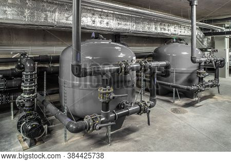Interior Of Modern Boiler Room. Piping System. Large Grey Boiler Units.