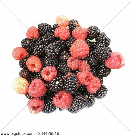 Raspberry And Blackberry Fruits Close-up. Natural Background From Fresh Berries. High Quality Photo