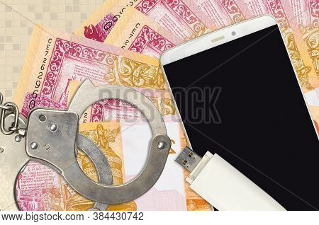 20 Belorussian Rubles Bills And Smartphone With Police Handcuffs. Concept Of Hackers Phishing Attack