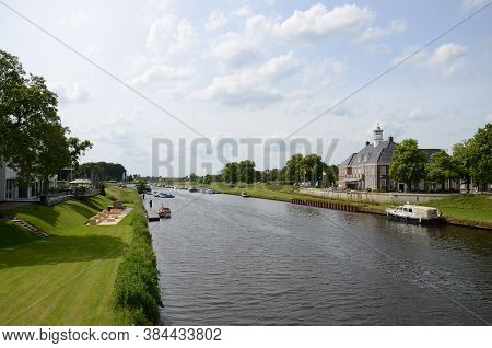 Waterside View With Boat On Water In Ommen The Netherlands