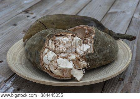 Baobab Fruit Or Adansonia Digitata On Plate, Pulp And Powder, Superfood On The Island Of Zanzibar, T