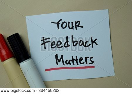 Your Feedback Matters Write On Sticky Notes Isolated On Office Desk.