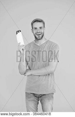 Handsome Man Hold Shampoo Bottle. Bearded Man Hold Gel Tube. Barbershop Grooming. Professional Barbe