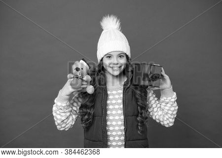 Why Not. Cute Little Girl Hold Mouse Toy. Child Knitted Winter Clothes Play With Toy Rat. Toy Shop F