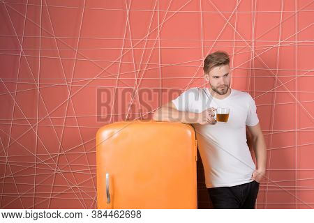Breakfast Refreshment And Energy. Man Hold Cup Of Tea Or Coffee In Kitchen. Macho At Retro Fridge On