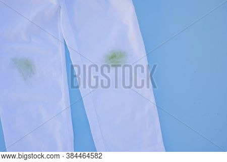 Dirty Grass Stain On White Pants.isolated On Blue Background.daily Life Dirty Stain For Wash And Cle