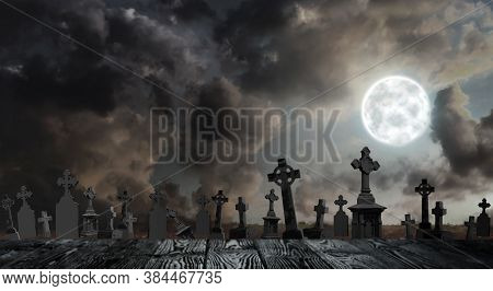 Wooden Surface And Moonlit Graveyard With Old Creepy Headstones. Halloween Banner Design