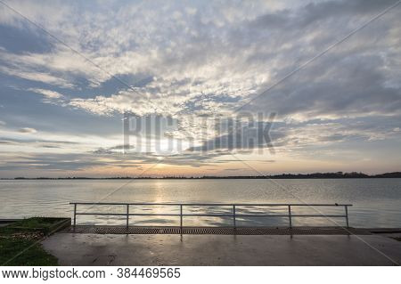 Palic Lake, In Subotica, Serbia, With A Green Lawn In The Background, During Aan Autumn Sunset. Also