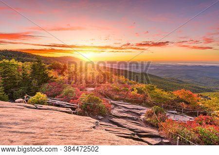 Grandfather Mountain, North Carolina, USA autumn sunrise from Rough Ridge in the Blue Ridge Mountains.
