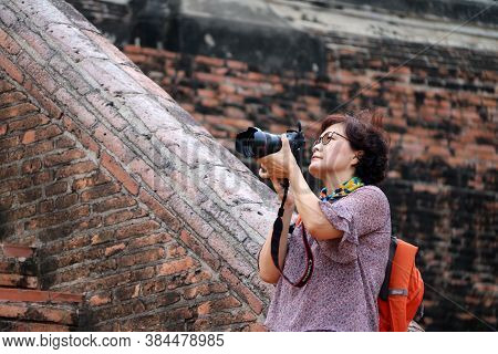 Ayutthaya, Thailand - Oct 9, 2018 : Women Tourists Taking Pictures And Background Ancient Brick At Y