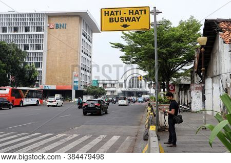Jakarta, Indonesia May 6, 2019: The Traffic On The Lada Road In Front Of Jakarta Kota Railway Statio