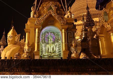Yangon, Myanmar Feb 21, 2019: Night Shot Of Stucco Buddha Statue Decorated In Golden Be Enshrined In
