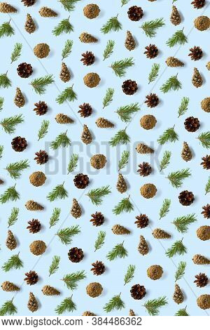 Pine Cone Christmas Background On Blue. Pine Branches And Cones. Minimal Creative Cone Arrangement P