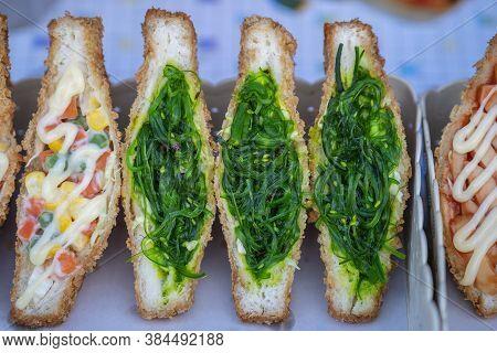 Seaweed Salad Sandwich For Sell At Street Food Market In Thailand . Tasty Green Seaweed Salad Sandwi