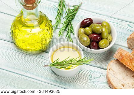 Ripe olives, olive oil and ciabatta bread