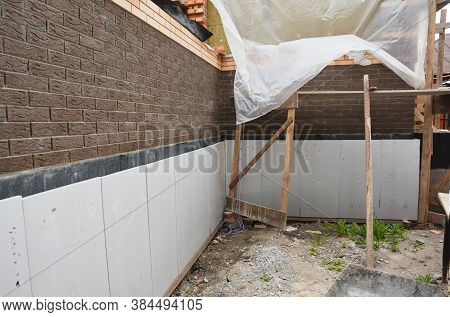 Foundation Foam Insulation And Damp Proofing In Problem Corner Area. House Basement, Foundation Foam