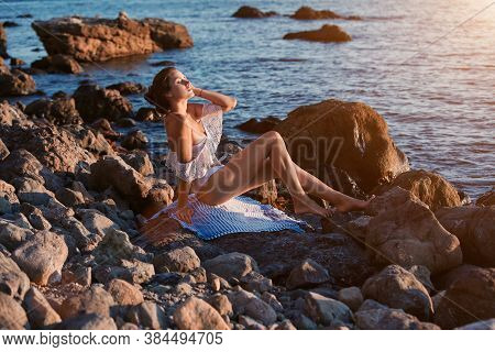 Contemplation And Relaxation. Meditation Time. Vacation Concept. Lady Resting On Beach. Sunbathing A