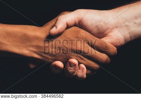 Black Lives Matter. Human Tolerance. Closeup Multicolor Male Hands Shaking Isolated On Dark. Ethnic